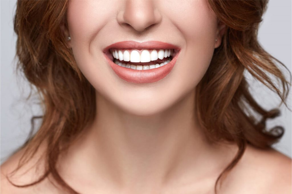 How Long Does Tooth Bonding Last? (4 Ways To Save On The Costs)