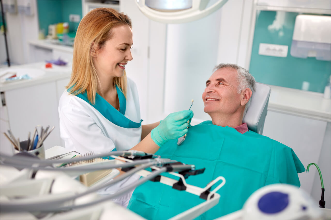 dentist and senior patient