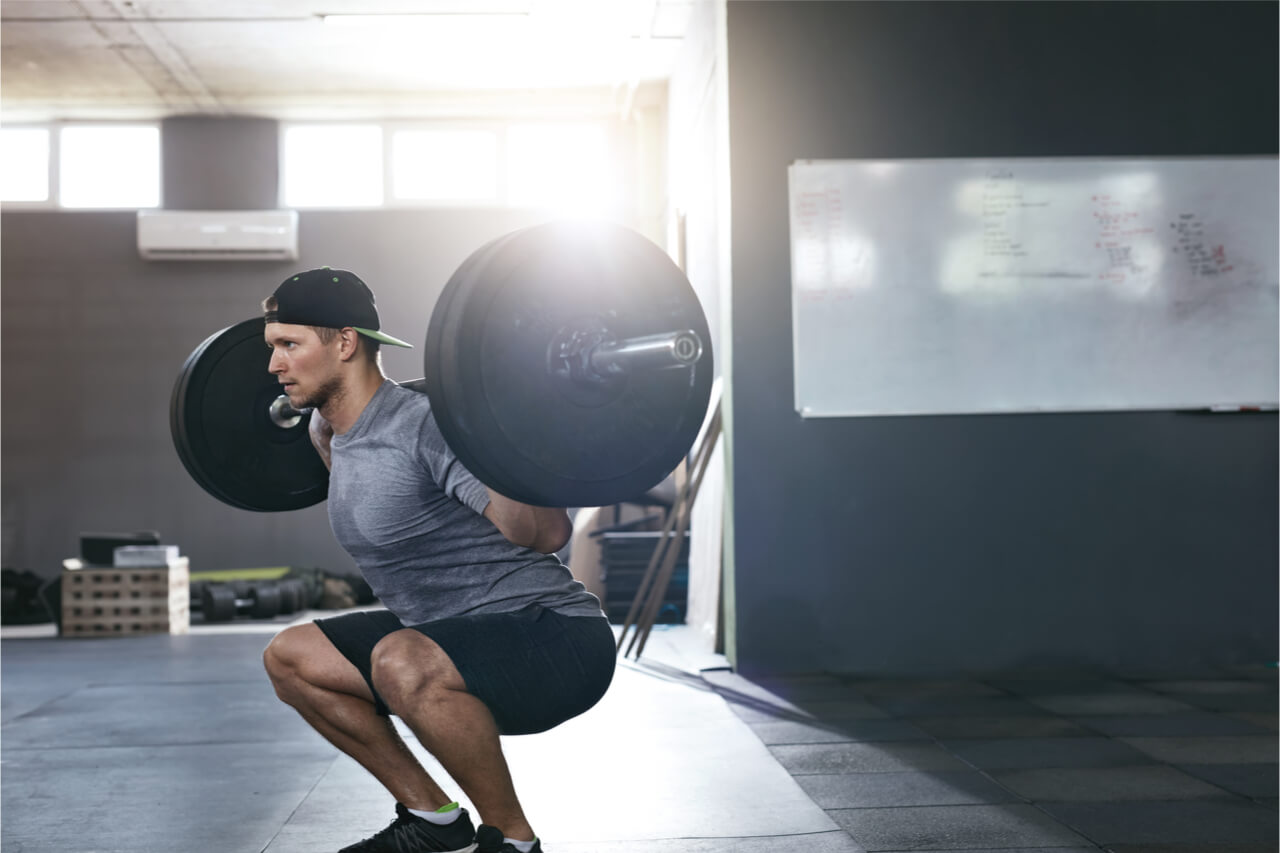 man on powerflift while squatting