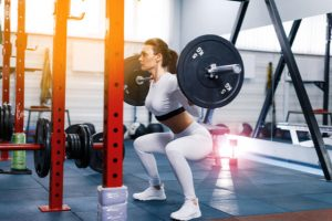 woman on powerlift while squatting